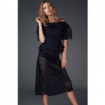 british made womenswear category siobhan malloy model woman in black luxury top and skirt