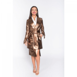 gold jacket and skirt by belles of london worn by a woman,