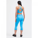 belles of london woman wearing a blue activewear leggings and top,
