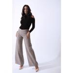 Womenswear model wearing zalinah white beige trousers and black long sleeve top