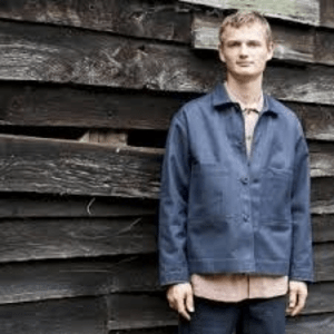 british sustainable menswear category image showing man modelling pajotten blue jacket