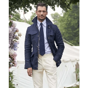 mens clothing made in uk category image showing a man wearing private white vc coat and white trousers