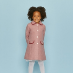 british childrens clothing, girl wearing a pink britannical coat