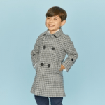 british childrens clothing category image showing a smart boy wearing a britnnical checked coat