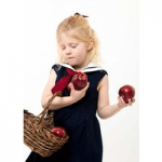 little cloth shop childrenswear girl in dress holding apples