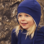 girl wearing a childrens superlove hat