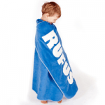 boy wrapped in blue mine london towel