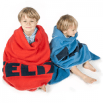 brothers sat on floor wrapped in red and blue mine london towels