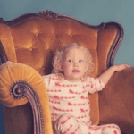 girl sat in chair wearing twinkledust pyjama set