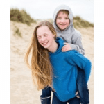bonnie uk girl giving boy a piggy back both wearing jumpers by bonnie uk
