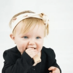 toddler girl wearing a headband by british babies clothing