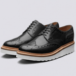 british made mens shoes category image showing a black brogue white sole goodyear welted shoe by grenso