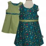 british childrens category image showing a reversible childrens green dress