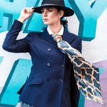 british made accessories category image showing a woman wearing a luxury scarf made by firehorse luxury accessories
