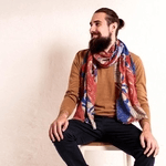 british made accessories showing a man sat down wearing a furious goose neck scarf