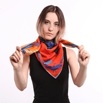 british made accessories showing a woman wearing a neck scarf by furious goose
