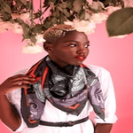 british made accessories category image showing a black woman wearing a silk scarf by furious goose