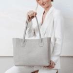 padfield, british made handbags, woman holding white handbag