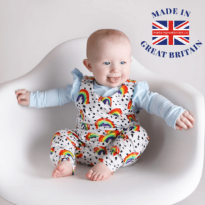 British Baby Brands, made in uk, cute baby hiding under a blanket with a teddy smiling
