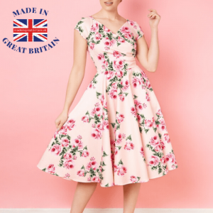 british womenswear brands, Woman in floral dress with plain peach background