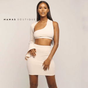 mamas boutique, black owned women's fashion uk business, black woman with long straight hair in sexy two piece top and skirt beige colour with plain background, black owned british made
