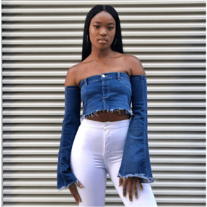 revival london, british sustainable denim brand, black owned british made, black owned business, black woman wearing denim redesigned recycled crop topand long sleeves