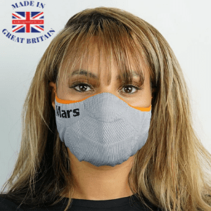 woman wearing a grey knitted mars face mask covering with blonde hair,