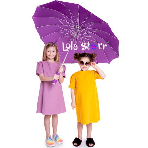lola starr,, two little girls in lilac and yellow dresses holding a purple umbrella,, made in uk, made in the uk