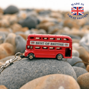 british made gifts and giftware, london bus with best of british sign on side keyring on pebble beach, made in great britain