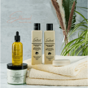 ethereall, british skincare brands, british haircare brand, bottles of skin and hair products next to towel and plant by ethereall skincare, made in britain, black owned british made