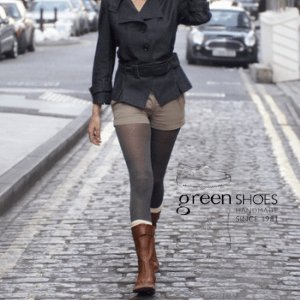 british made women's shoes, woman wearing brown boots walking down street in britain near a mini car on double yellow lines by green shoes of dartmoor