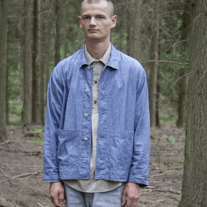 men's clothing made in britain, british men's clothing, british made men's clothing, pajottem, young man wearing denim workwear standing in a wood, sustainable men;s clothing brand