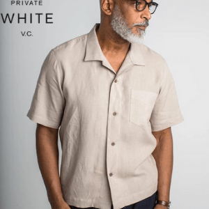 men's clothing made in britain, british made men's clothes, men's clothes made in britain, private white vc, asian man in linen short sleeved shirt wearing glasses