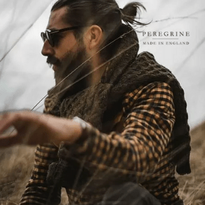 peregrine clothing, men's clothing made in britain, man with beard and sunglasses sat in a field wearing country clothing made in england