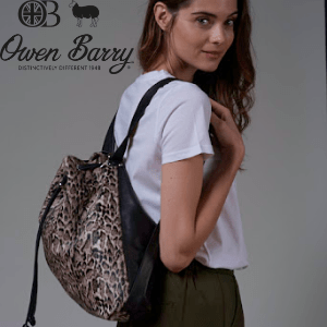 British handbag brands, woman wearing a british made designer handbag backpack