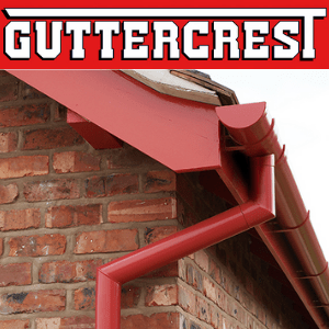 red guttering on a brick house by guttercrest, uk home improvement
