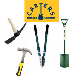 selection of british made hand tools including a spade loppers pick axe and claw hammer made by richard carters toolmakers, british made tools, british tools