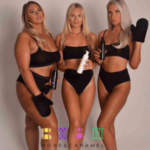 rose and caramel, 3 women in black underwear holding up self tan products made in britain and self tan mit with blonde hair and golden tan, best british beauty brands