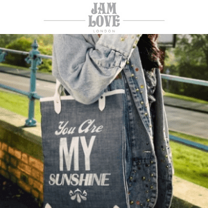 woman in denim jacket with a jam love london shoulder bag that is made in britain from finest materials
