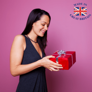 British woman receiving a gift wrapped boxed present suprise, british gifts for her, christmas gifts for her
