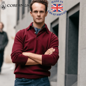 posh gent with arms folded wearing a classic burgundy men's polo shirt by Cordings