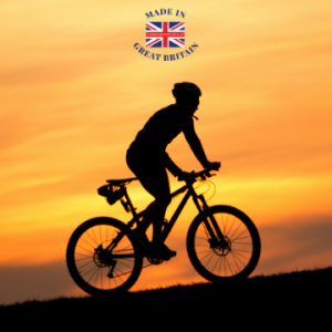 silhouette of a man riding a bicycle against a sun rise or set background, british bicycles and equipment, cycling clothing made in uk, british clothing brands, cycling clothing ,