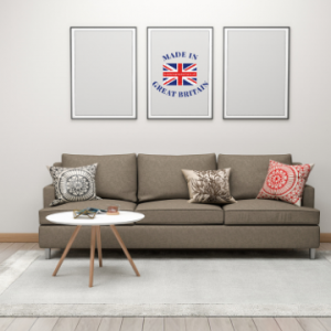 british made furniture brands, made in britain, sofa and side table with blue background, british blog, modern sofa in living room with small coffee table and made in great britain picture on wall