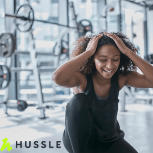 mixed race woman in gym, hussle pay as u gym, no contract gym passes around the uk