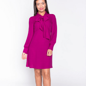 belles of london, british made women's clothes, british women's clothing, woman wearing dark pink purple cerise coloured long sleeved short skirt dress by belles of london, women's clothes made in britain