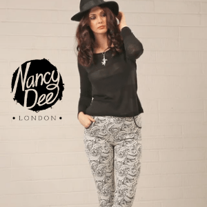 Nancy Dee, woman wearing a black trilby and top and trousers by nanct dee london, women's clothes made in britain