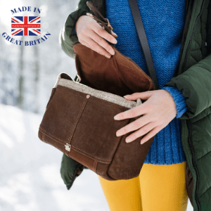 woman opening brown handbag in winter scene, british christmas gifts, uk christmas gifts, buy buy christmas gifts uk