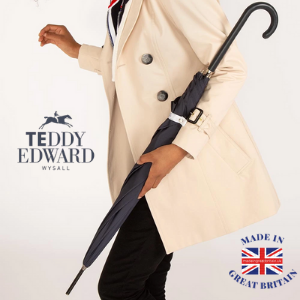 british made umbrella by teddy edward held by a young black woman, luxury umbrella made in uk