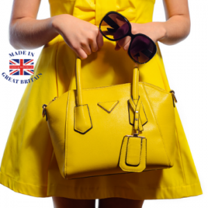 woman with yellow handbag and sunglasses made in britain, british business directory, handbags and accessories