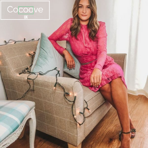 cocoove womens uk made clothing brand, woman in pink going out dress sat of a sofa, women's clothes made in britain